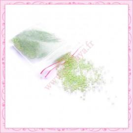 20g de micro-billes en verre transparente vert pomme 1.5mm
