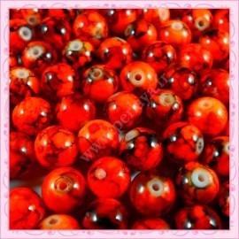 Lot de 100 perles en verre orange fluo - noire effet tacheté